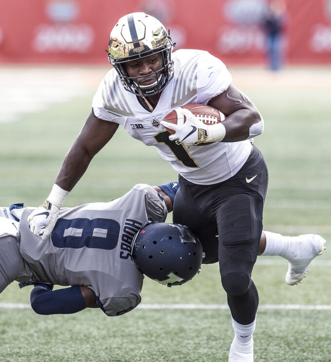 Purdue running back D.J. Knox (1) avoids being tackled by Illinois' Nate Hobbs (8) in the first half of an NCAA college football game, Saturday, Oct. 13, 2018, in Champaign, Ill. (AP Photo/Holly Hart)