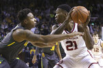 Baylor guard Mark Vital (11) guards Oklahoma forward Kristian Doolittle (21) in the first half of an NCAA college basketball game Monday, Jan. 20, 2020, in Waco, Texas. (AP photo/ Jerry Larson)