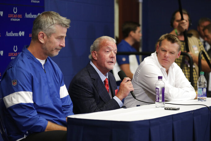 Indianapolis Colts owner Jim Irsay, middle, speaks during a news conference after the team's NFL preseason football game against the Chicago Bears, Saturday, Aug. 24, 2019, in Indianapolis. Colts quarterback Andrew Luck announced that he his retiring at age 29. Colts coach Frank Reich is at left, and general manager Chris Ballard is at right. (AP Photo/Michael Conroy)