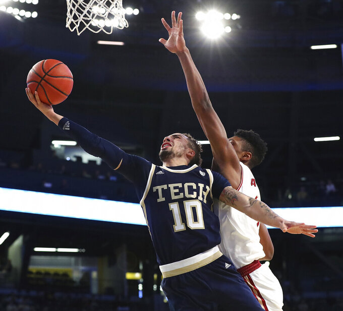 Georgia Tech guard Jose Alvarado (10) draws a foul from Boston College defender Jarius Hamilton on his way to the basket in an NCAA college basketball game, Sunday, March 3, 2019, in Atlanta. (Curtis Compton/Atlanta Journal-Constitution via AP)