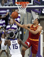TCU forward JD Miller (15) watches as Iowa State guard Talen Horton-Tucker (11) goes up for a reverse layup in the second half of an NCAA college basketball game in Fort Worth, Texas, Saturday, Feb. 23, 2019. (AP Photo/Tony Gutierrez)