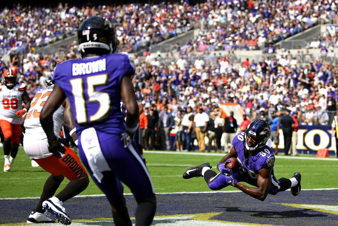 Baltimore Ravens wide receiver Miles Boykin catches a touchdown pass from quarterback Lamar Jackson during the first half of an NFL football game against the Cleveland Browns Sunday, Sept. 29, 2019, in Baltimore. (AP Photo/Nick Wass)