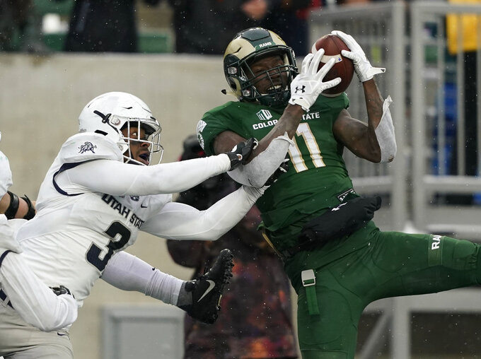Colorado State wide receiver Preston Williams (11) pulls in a would be game-winning touchdown pass in the end zone with no time left on the clock against Utah State safety Jontrell Rocquemore (3) during an NCAA football game Saturday, Nov. 17, 2018, in Fort Collins, Colo. The official call was Williams stepped out of bounds and came back in so the catch was no good. Utah State beat Colorado State 29-24. (AP Photo/Jack Dempsey)