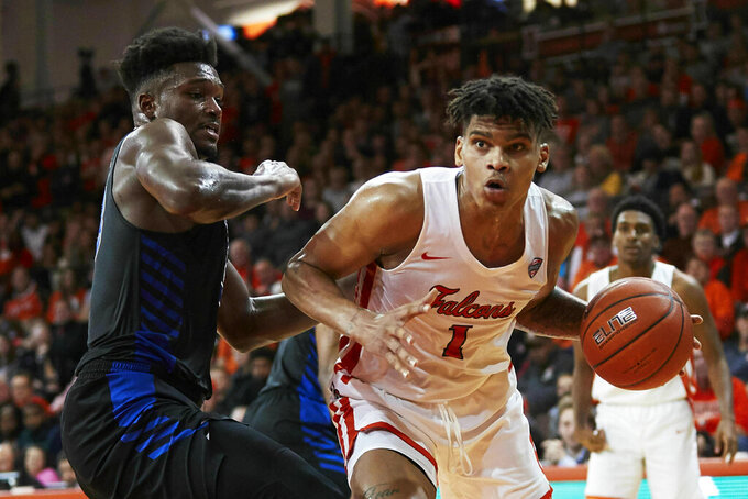 Bowling Green forward Demajeo Wiggins (1) dribbles while defended by Buffalo forward Nick Perkins, left, in the second half of an NCAA college basketball game in Bowling Green, Ohio, Friday, Feb. 1, 2019. (AP Photo/Rick Osentoski)