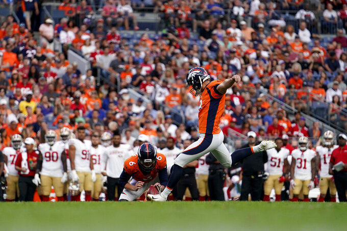 Denver Broncos kicker Brandon McManus as punter Colby Wadman (6) holds kicks a field goal as during an NFL preseason football game against the San Francisco 49ers, Monday, Aug. 19, 2019, in Denver. (AP Photo/Jack Dempsey)