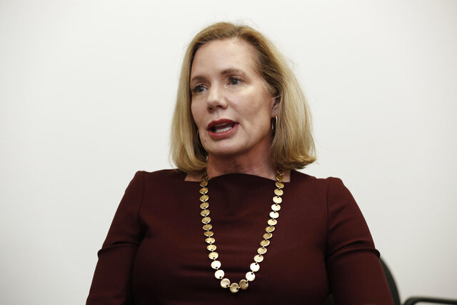In this photo taken Thursday, Feb. 13, 2020 Holly Grange, who is running for the Republican nomination for governor in the North Carolina primary, is seen during an interview in Raleigh, N.C. (AP Photo/Gerry Broome)