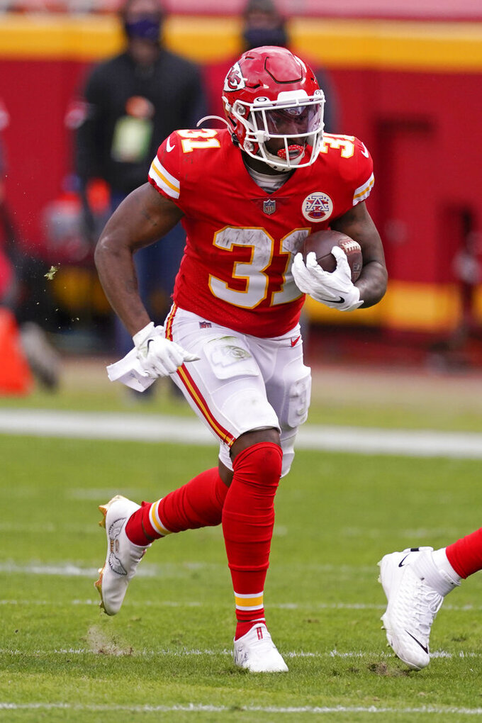 Kansas City Chiefs running back Darrel Williams carries the ball up field during the first half of an NFL divisional round football game against the Cleveland Browns, Sunday, Jan. 17, 2021, in Kansas City. (AP Photo/Charlie Riedel)