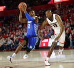 Kentucky guard Ashton Hagans (2) drives last Georgia forward E'Torrion Wilridge (13) during the first half of an NCAA college basketball game Tuesday, Jan. 15, 2019, in Athens, Ga. Kentucky won 69-49. (AP Photo/John Bazemore)