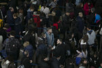 FILE - In this Jan. 7, 2019, file photo passengers wait in line at New York's John F. Kennedy International Airport. Airlines expect record crowds over the week-long Labor Day period, continuing a rise in travel that has boosted the airlines' profits all year. (AP Photo/Mark Lennihan, File)