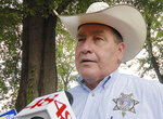 FILE - In this July, 9, 2008 file photo, Limestone County, Ala., Sheriff Mike Blakely speaks to the media following the crash of a small airplane. Blakely, who is in his 10th term in office, was arrested on Thursday, Aug. 22, 2019, on multiple theft and ethics charges, according to the Alabama attorney general's office. (Kim Rynders/Athens News Courier via AP)