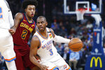 Oklahoma City Thunder guard Chris Paul (3) drives around Cleveland Cavaliers guard Collin Sexton (2) during the first half of an NBA basketball game Wednesday, Feb. 5, 2020, in Oklahoma City. (AP Photo/Sue Ogrocki)