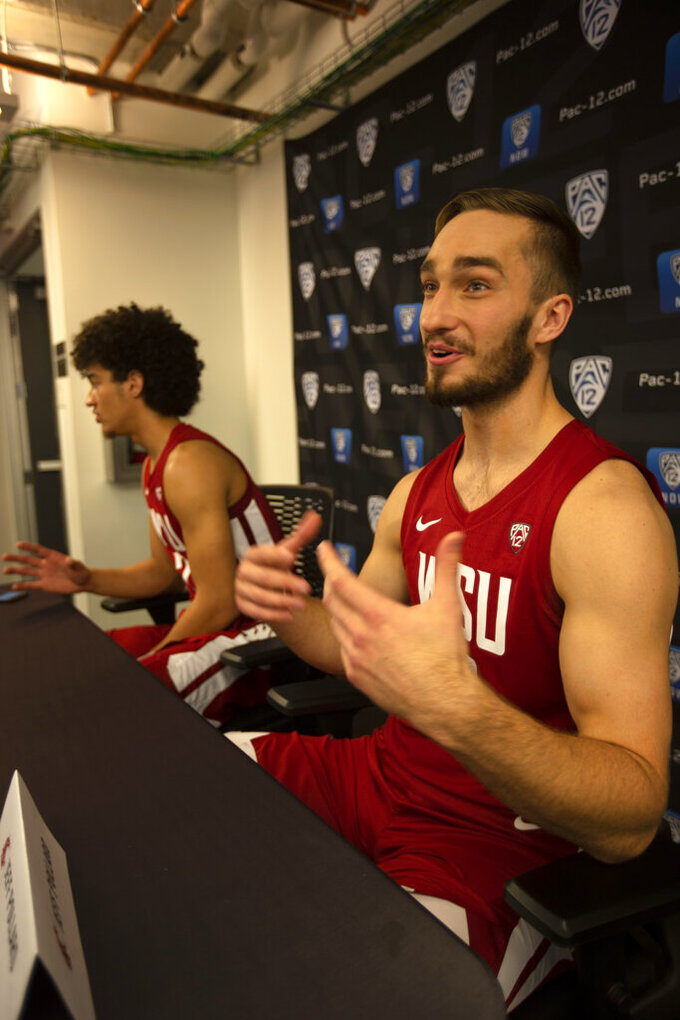 Washington State's CJ Elleby, left, and Jeff Pollard speak during the Pac-12 NCAA college basketball media day Tuesday, Oct. 8, 2019 in San Francisco. (AP Photo/D. Ross Cameron)