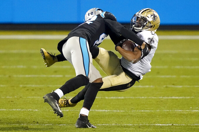 New Orleans Saints wide receiver Emmanuel Sanders is tackled by Carolina Panthers safety Sam Franklin during the second half of an NFL football game Sunday, Jan. 3, 2021, in Charlotte, N.C. (AP Photo/Gerry Broome)