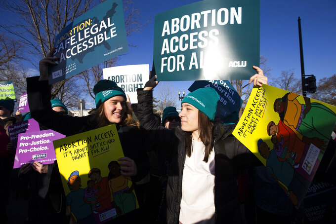 Abortion rights demonstrators rally outside of the U.S. Supreme Court in Washington, Wednesday, March 4, 2020. Among abortion-rights activists, there's relief and optimism as the Biden administration takes power  Biden is expected to soon issue executive orders reversing anti-abortion actions taken by Trump. (AP Photo/Jose Luis Magana, File)