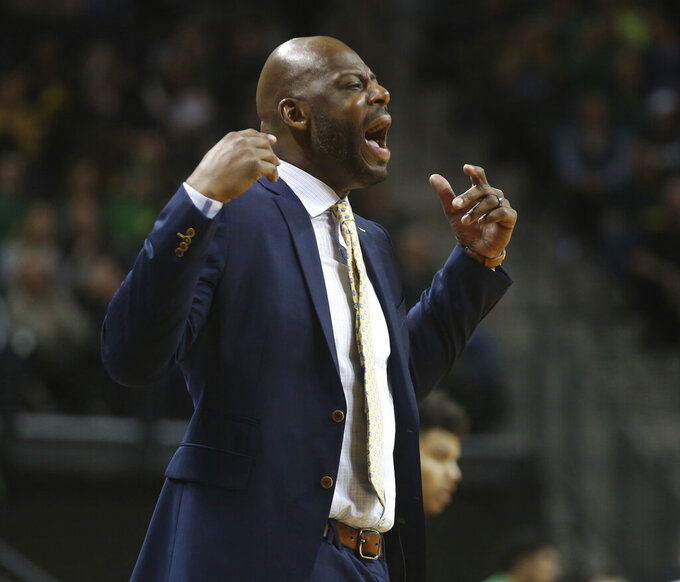 California coach Wyking Jones calls a timeout during the first half of the team's NCAA college basketball game against Oregon on Wednesday, Feb. 6, 2019, in Eugene, Ore. (AP Photo/Chris Pietsch)