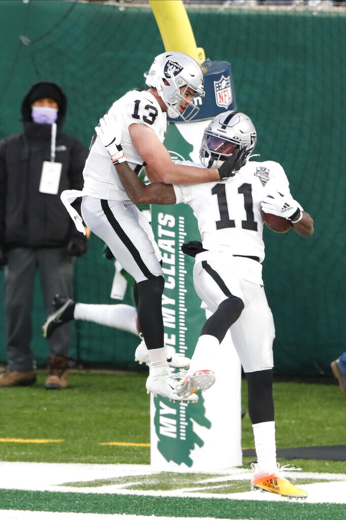 Las Vegas Raiders' Henry Ruggs III, right, celebrates his touchdown with Hunter Renfrow during the second half an NFL football game against the New York Jets, Sunday, Dec. 6, 2020, in East Rutherford, N.J. (AP Photo/Noah K. Murray)