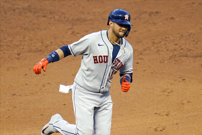 Houston Astros Yuli Gurriel jogs home on a solo home run off Minnesota Twins relief pitcher Jorge Alcala to tie a baseball game in the sixth inning Friday, June 11, 2021, in Minneapolis. (AP Photo/Jim Mone)