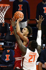 Indiana's forward Trayce Jackson-Davis (23) puts up a shot as Illinois center Kofi Cockburn (21) defends in the first half of an NCAA college basketball game Saturday, Dec. 26, 2020, in Champaign, Ill. (AP Photo/Holly Hart)
