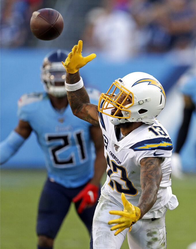 Los Angeles Chargers wide receiver Keenan Allen (13) reaches for a pass against the Tennessee Titans in the second half of an NFL football game Sunday, Oct. 20, 2019, in Nashville, Tenn. (AP Photo/James Kenney)