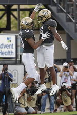 Central Florida wide receiver Gabriel Davis, left, celebrates his 38-yard touchdown catch against Stanford with teammate wide receiver Marlon Williams (6) during the first half of an NCAA college football game, Saturday, Sept. 14, 2019, in Orlando, Fla. (AP Photo/John Raoux)