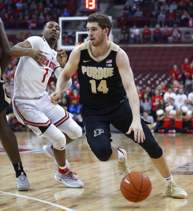 Purdue's Ryan Cline, right, drives to the basket against Ohio State's Luther Muhammad during the first half of an NCAA college basketball game Wednesday, Jan. 23, 2019, in Columbus, Ohio. (AP Photo/Jay LaPrete)