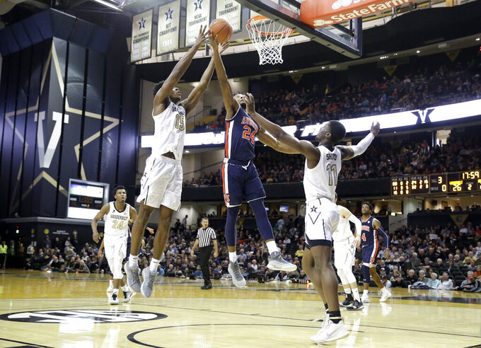 Vanderbilt forward Clevon Brown (15) and Auburn forward Anfernee McLemore (24) reach for a rebound in the second half of an NCAA college basketball game Saturday, Feb. 16, 2019, in Nashville, Tenn. (AP Photo/Mark Humphrey)