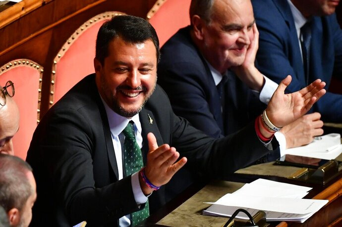 Italian Deputy-Premier Matteo Salvini opens his arms at the Senate, in Rome, Tuesday, Aug. 20, 2019. Italian Premier Giuseppe Conte on Tuesday announced his resignation, blaming his decision to end his 14-month-old populist government on his rebellious and ambitious deputy prime minister Matteo Salvini.  (Ettore Ferrari/ANSA via AP)