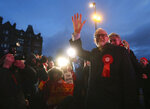 Britain's Main opposition Labour Party leader Jeremy Corbyn, waves to supporters on the last day of campaigning ahead of the General Election, in Glasgow, Scotland, Wednesday Dec. 11, 2019.  Britain goes to the polls in a General Election on Dec. 12. (Andrew Milligan/PA via AP)