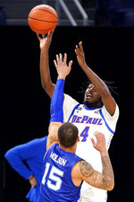 DePaul guard Javon Freeman-Liberty, top, shoots over Seton Hall guard Takal Molson during the second half of an NCAA college basketball game in Chicago, Saturday, Jan. 9, 2021. (AP Photo/Nam Y. Huh)