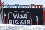 A snowboarder practices for the Big Air Atlanta snowboard and ski competition at SunTrust Park Thursday, Dec. 19, 2019, in Atlanta. (AP Photo/John Bazemore)