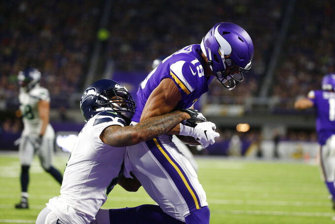 Minnesota Vikings wide receiver Brandon Zylstra catches a 4-yard touchdown pass in front of Seattle Seahawks cornerback Jamar Taylor, left, during the second half of an NFL preseason football game, Sunday, Aug. 18, 2019, in Minneapolis. (AP Photo/Bruce Kluckhohn)