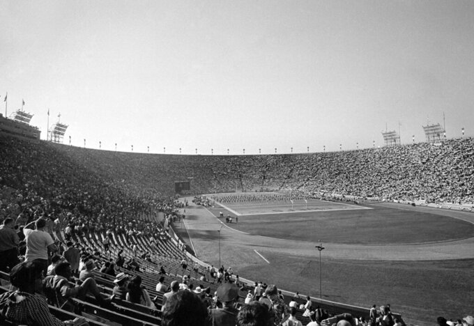 FILE - In this Jan. 15, 1967, file photo, thousands of fans attend the first AFL-NFL World Championship Game — now known as Super Bowl I — between the Green Bay Packers and the Kansas City Chiefs in Los Angeles. Green Bay's proven old pros carried the National Football League to a 35-10 victory over the Chiefs of the American Football League in the first Super Bowl under the brilliant direction of Bart Starr. (AP Photo/File)