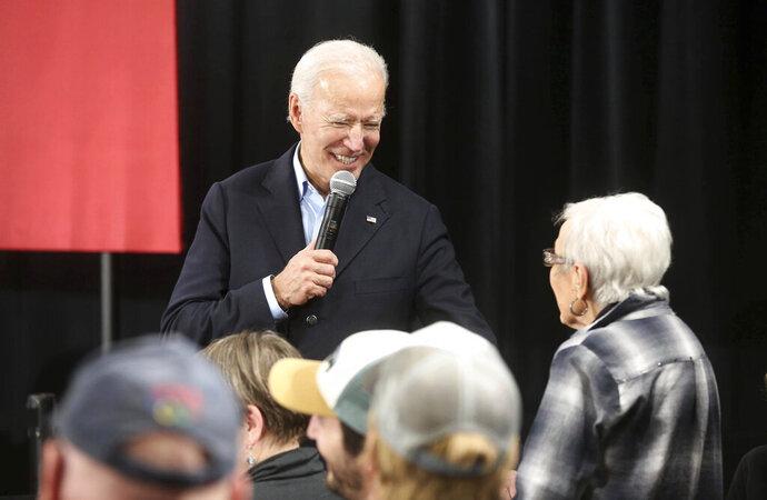 Democratic presidential candidate and former Vice President Joe Biden speaks with Marjorie Costigan, of Elkader, Iowa, during his