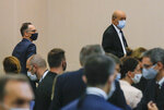 German Foreign Minister Heiko Maas, left, and French Foreign Minister Jean-Yves Le Drian wearing masks arrive for the opening session of the French ambassadors to European countries in Paris, Monday, Aug. 31, 2020. (AP Photo/Michel Euler)