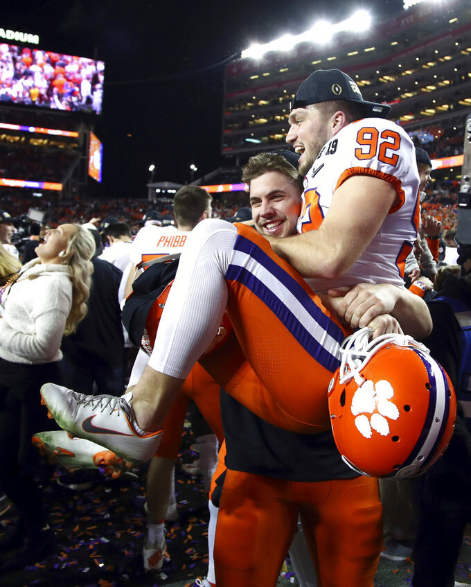 Clemson's Greg Huegel leaps in the arms of a teammate after the NCAA college football playoff championship game against Alabama, Monday, Jan. 7, 2019, in Santa Clara, Calif. Clemson beat Alabama 44-16. (AP Photo/Ben Margot)