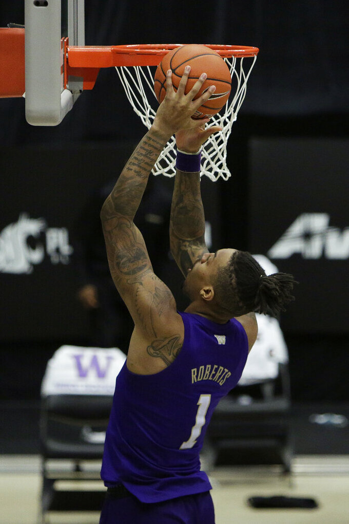 Washington forward Nate Roberts shoots during the second half of an NCAA college basketball game against Washington State in Pullman, Wash., Monday, Feb. 15, 2021. (AP Photo/Young Kwak)