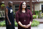 """Bethany Racobs-Ashford poses for a photo with her husband, Chase, rear, at her mother's home in Dallas, Wednesday, Aug. 5, 2020. Racobs-Ashford said that the extra $600 in federal benefits was a """"lifeline"""