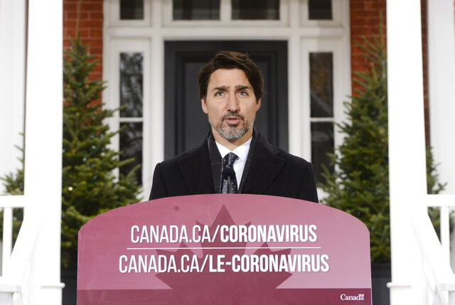 Canada Prime Minister Justin Trudeau addresses Canadians on the COVID-19 pandemic from Rideau Cottage in Ottawa, Ontario, Friday, April 3, 2020. (Sean Kilpatrick/The Canadian Press via AP)