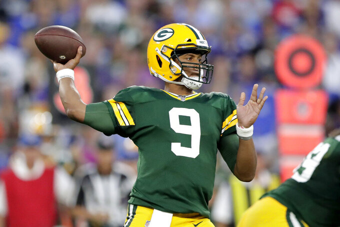 Green Bay Packers quarterback DeShone Kizer throws a pass against the Green Bay Packers during the first half of a NFL football preseason game, Thursday, Aug. 15, 2019, in Baltimore. (AP Photo/Julio Cortez)