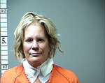 """FILE - This 2016 file booking photo, provided by the St. Charles County, Mo., Prosecuting Attorney's Office shows Pamela Hupp. The Missouri woman serving a life sentence for killing a mentally disabled man has been charged with another murder. The St. Louis Post-Dispatch reports Hupp, 62, on Monday, July 12, 2021, was charged with first-degree murder and armed criminal action for the 2011 killing of her friend Elizabeth """"Betsy"""" Faria. Lincoln County Prosecuting Attorney Mike Wood says Hupp staged Faria's death to make it look like her husband did it. (St. Charles County Missouri, Prosecuting Attorney's Office via AP, File)"""