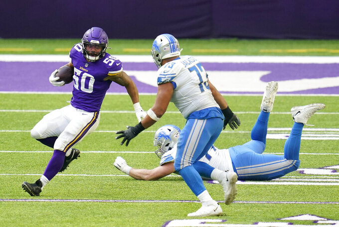 Minnesota Vikings linebacker Eric Wilson (50) runs from Detroit Lions' Frank Ragnow and Jonah Jackson (73) after intercepting a pass during the second half of an NFL football game, Sunday, Nov. 8, 2020, in Minneapolis. (AP Photo/Jim Mone)