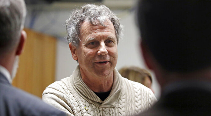 U.S. Sen. Sherrod Brown, D-Ohio, smiles as he speaks with guests prior to an economic roundtable discussion at Winnacunnet High School in Hampton, N.H., Friday, Feb. 8, 2019. Sen. Brown is weighing a run for in 2020 presidential race. (AP Photo/Charles Krupa)
