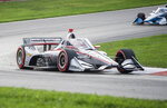 Will Power, of Australia, exits a turn in the lead during the IndyCar Series auto race at Mid-Ohio Sports Car Course, Saturday, Sept. 12, 2020, in Lexington, Ohio. (AP Photo/Phil Long)
