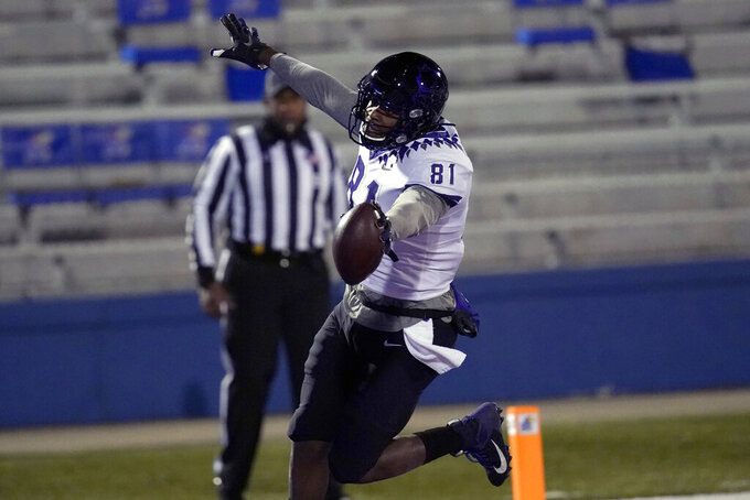 TCU tight end Pro Wells (81) celebrates after scoring a touchdown during the first half of an NCAA college football game against Kansas in Lawrence, Kan., Saturday, Nov. 28, 2020. (AP Photo/Orlin Wagner)