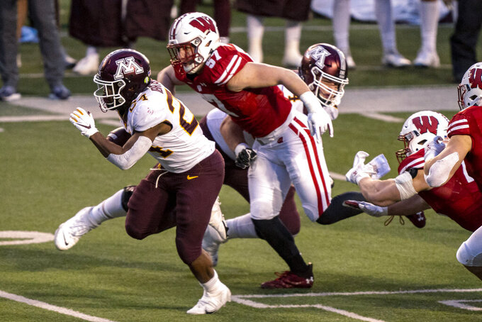 FILE - In this Dec. 19, 2020, file photo, Wisconsin linebacker Jack Sanborn chases Minnesota running back Mohamed Ibrahim (24) during the first half of an NCAA college football game in Madison, Wis. Sanborn collected a team-high 52 tackles last season to help Wisconsin place fifth nationally in total defense and tie for ninth in scoring defense. He will lead Wisconsin's defense again when the 12th-ranked Badgers open their season Saturday by hosting No. 19 Penn State. (AP Photo/Andy Manis, File)