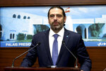 In this photo released by Lebanon's official government photographer Dalati Nohra, Lebanese Prime Minister Saad Hariri, speaks after a cabinet meeting, at the presidential palace, in Baabda, east of Beirut, Lebanon, Monday, Oct. 21, 2019. Lebanon's Cabinet approved Monday sweeping reforms that it hopes will appease hundreds of thousands of people who have been protesting for days, calling on Prime Minister Saad Hariri's government to resign. (Dalati Nohra via AP)