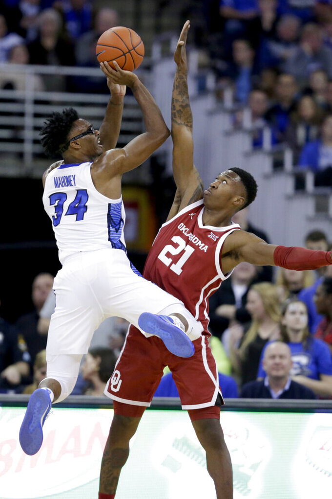 Creighton's Denzel Mahoney (34) shoots against the defense of Oklahoma's Kristian Doolittle (21) during the first half of an NCAA college basketball game in Omaha, Neb., Tuesday, Dec. 17, 2019. (AP Photo/Nati Harnik)