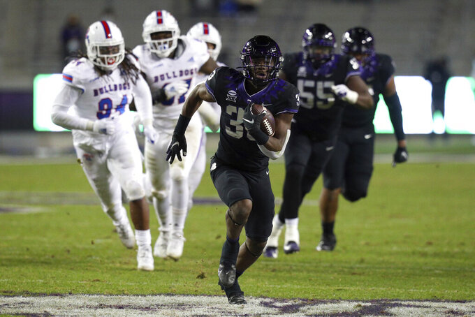 TCU running back Kendre Miller (33) carries the ball on a touchdown run against Louisiana Tech in the third quarter during an NCAA college football game, Saturday, Dec. 12, 2020. (AP Photo/ Richard W. Rodriguez)