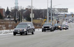A hearse is seen in the procession as police vehicles leave Froedtert Hospital in Milwaukee, Wis., on Wednesday, Feb. 6, 2019, on their way to the Medical Examiners office with the hearse containing the body of a fallen Milwaukee Police officer. The Milwaukee Police Department is in mourning for the third time in less than a year after an officer was shot and killed Wednesday morning. The officer, whose name has not been released, was a member of the Tactical Enforcement Unit and was part of the team serving a search warrant at a house on the city's south side when he was shot with a rifle, according to three law enforcement sources.  (Mike De Sisti/Milwaukee Journal-Sentinel via AP)