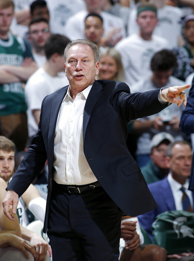 Michigan State coach Tom Izzo gives instructions against Ohio State during the first half of an NCAA college basketball game, Sunday, March 8, 2020, in East Lansing, Mich. Michigan State won 80-69. (AP Photo/Al Goldis)